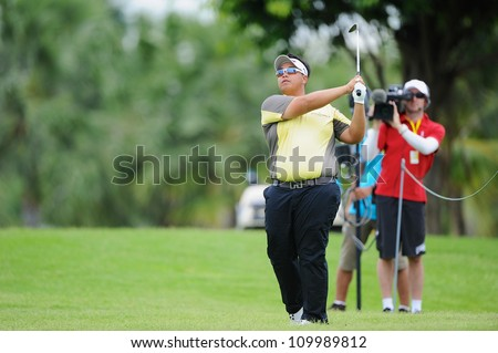 NAKHONPATHOM,THAILA ND-AUG 10: Kiradech Aphibarnrat of THA hits a shot during hole12 day two of the Golf Thailand Open at Suwan Golf Club on August 10, 2012 in Nakhonpathom Thailand