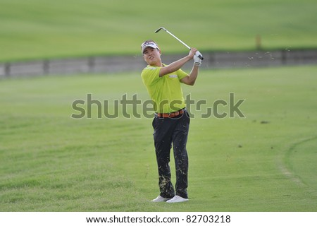 NAKHONPATHOM,THAILAND - AUG 12:Kim Hyung-Tae of KOR in action during day two of the 2011 Thailand Open at Suwan Golf&Country Club on August 12, 2011 in Nakhonpathom Thailand