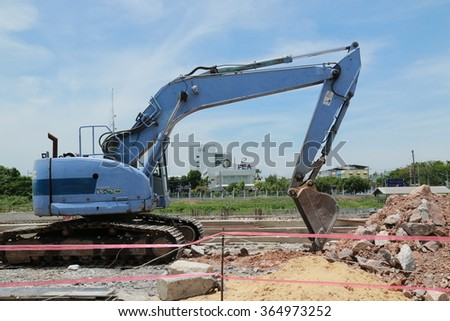 NAKHONPRATHOM-THAILAND-JUNE 6 : The tractors loader on the work-site on June 6, 2015 Nakhonprathom Province, Thailand. - stock photo