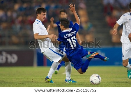 NAKHONRATCHASIMA THAILAND-FEB 04:Chanathip Songkrasin No.18 of Thailand in action during the 43rd King's cup between Thailand and Uzbekistan at Nakhon ratchasima stadium on Feb 04,2015 in Thailand.