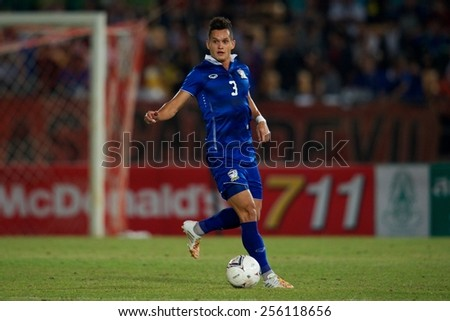 NAKHONRATCHASIMA THAILAND-FEB 04:Mika Chunuonsee of Thailand control the ball during the 43rd King's cup between Thailand and Uzbekistan at Nakhon ratchasima stadium on Feb 04,2015 in Thailand. - stock photo