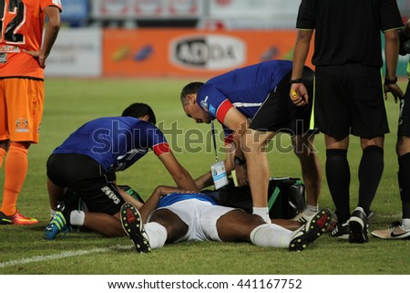 NAKHONRATCHASIMA THAILAND-JUN22: Doctors stand by for help injured player in action during ThaiLeague Army United F.C.and Nakhon Ratchasima FCat 80th Birthday Stadium on June22,2016 in Thailand. - stock photo