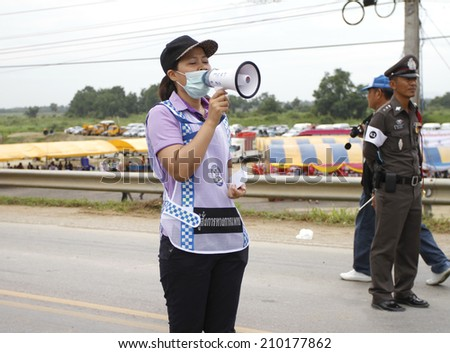 NAKHONSAWAN/THAILAND-JULY 31: Exercise Management for group accident on July 31, 2014 in Nakhonsawan. Medical commandership notifies all the victims, Rescue and Medical Personnel working. - stock photo