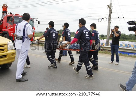 NAKHONSAWAN/THAILAND-JULY 31: Exercise Management for group accident on July 31, 2014 in Nakhonsawan. Rescue and Medical Personnel teams screen, treat, and transfer the accidental victims.