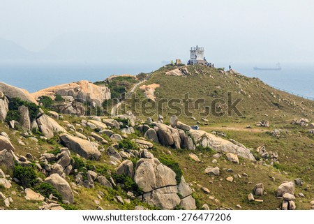 Nam Kok Tsui lighthouse in Po Toi Islands in Hong Kong. - stock photo