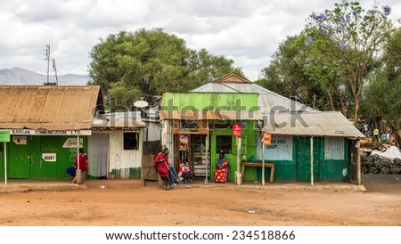NAMANGA, KENYA - OCTOBER 20, 2014 : Typical street scene in Namanga. Namanga is a town lying on the border between Kenya and Tanzania in Kajiado District, Rift Valley Province. - stock photo