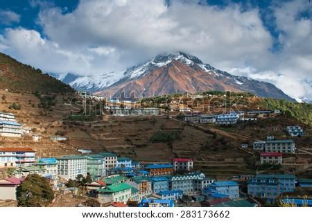 Namche Bazaar  - big village in Himalayas on the way to Everest base camp in Sagarmatha National Park, Nepal  - stock photo
