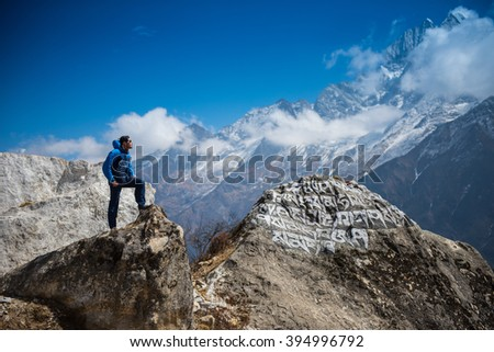 NAMCHE BAZAR NEPAL  MARCH 2016 : man traveler hiking to the top of Namche bazar view point at namche bazar solokhumbu nepal  7 march 2016