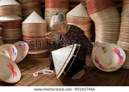 Namdinh, Vietnam - June 14, 2015: A woman sat sewing the traditional conical hats. This is a woman's hat is the most popular Vietnam.