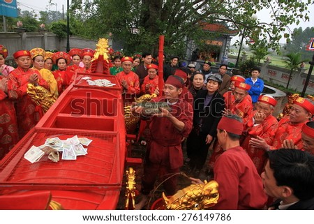 NAMDINH, VIETNAM - MARCH 02: An unidentified group of people the traditional festival celebrations in the Tet Lunar New Year on March 02, 2015 in Nam Dinh.