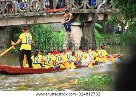 NAMDINH, VIETNAM October 3, 2015: Group of unidentified woman sailing on a small river in a traditional festival in namdinh, Vietnam.