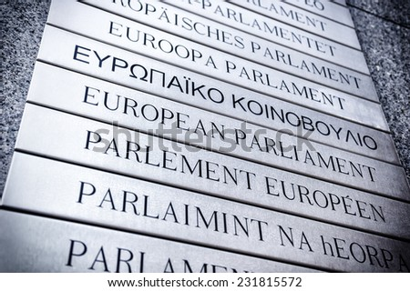 Nameplate in all EU languages in front of the European Parliament. Brussels, Belgium - stock photo