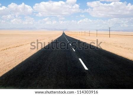 Namib Desert - Road through desert of Namib in Namibia - stock photo