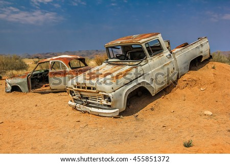 Namibia desert area, Namibia, Africa - August 25, 2012: Cars wreck in the desert near a solitaire small ghost town in the dunes.