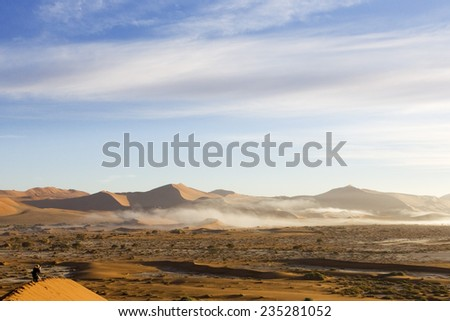 Namibia, Fog from the atlantic between red dunes, Africa - stock photo