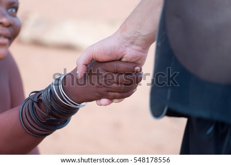NAMIBIA - November 28, 2016, handshake of african woman and white man