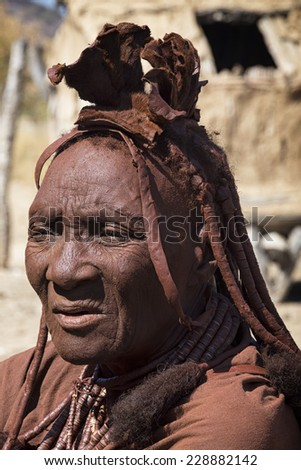 Namibia 24/08/2014:  the Himba tribe has the feature to have girls that don't wash their selves but cover the skin with a red mud allover the body. They use to perfume themselves with incense - stock photo