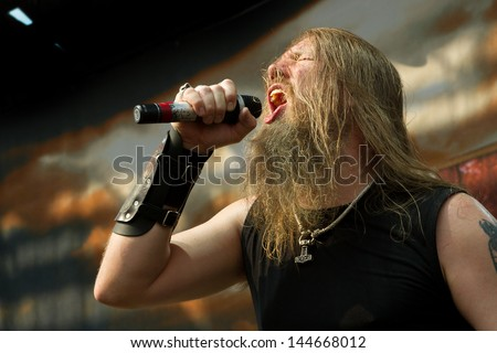 NAMPA/IDAHO - JULY 2: Johan Hegg from Amon Amarth, a death metal band from Sweeden performing on stage at the Rockstar Mayhem Festival in Nampa, Idaho 2013