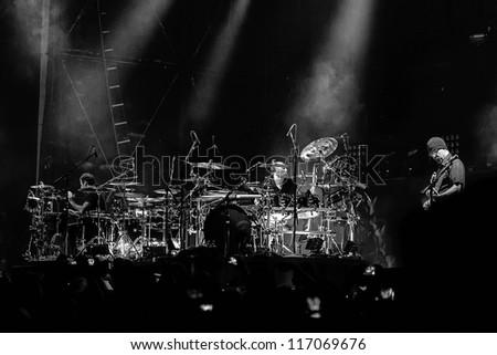 NAMPA, IDAHO - SEPTEMBER 25 : Godsmack having it's drum duel with Tony Rombola playing guitar at the Rockstar Uproar Festival on September 25, 2012 in Nampa, Idaho. - stock photo