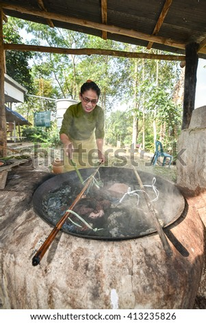NAN, THAILAND - JANUARY 15, 2016 : Unidentified woman are dyeing cotton with natural materials.