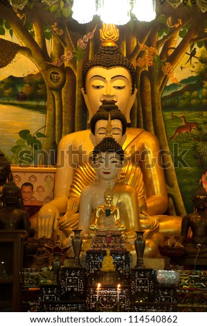 NAN, THAILAND - SEPTEMBER 23: Three ancient buddhas age of about 100 years in Old church of Wat Khu Khum temple on September 23, 2012 in Nan province, Northern of Thailand . - stock photo