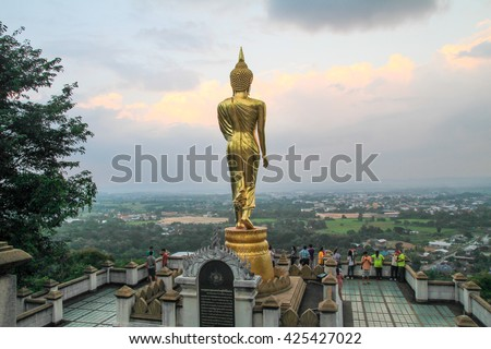 NAN, THILAND, OCTOBER 18: Golden Buddha image of Wat Phra That Khao Noi, Buddhist Temple and Historic Site National Nan, northern of Thailand on October 18, 2014 in Nan, Thailand.  - stock photo