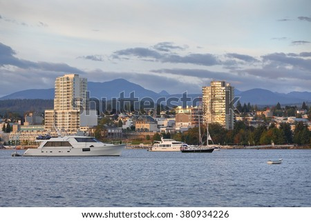 Nanaimo Morning, Water View, British Columbia. Waterfront condominiums overlook the harbor and marina in Downtown Nanaimo, British Columbia, Canada.  - stock photo