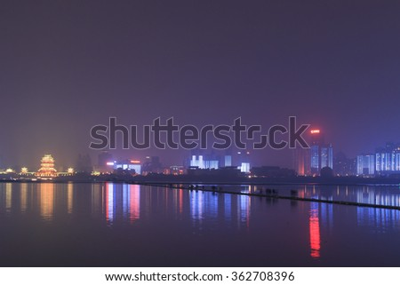 Nanchang, China - January 3, 2015: Nanchang skyline at night as seen from the east side of the city. Nanchang is the capital of Jianxi province in China