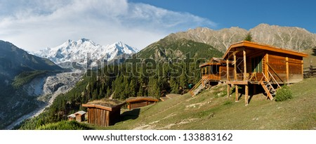 Nanga Parbat and Fairy Meadows Panorama. The world's ninth highest peak seen from the idyllic Fairy Meadows, Pakistan. - stock photo