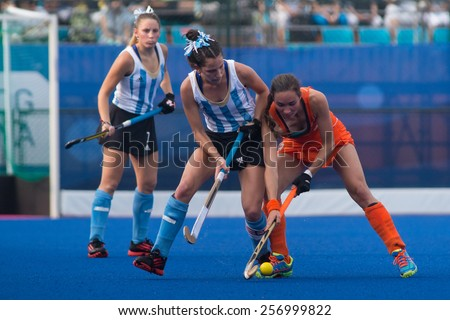 NANJING, CHINA-AUGUST 20: Argentina Hockey Team (white-blue) plays against Holland Hockey Team (orange) during Day 4 match of 2014 Youth Olympic Games on August 20, 2014 in Nanjing, China.