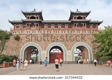 NANJING-MAY 26, 2014. Ancient gate to Zhongshan scenic area. Nanjing, capital of Jiangsu province, is a city with a very rich history. It was the national capital during a part of the Ming dynasty. - stock photo