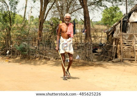 Nannilam, India - 11 May 2016: old man walking on the street