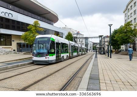 NANTES, FRANCE - CIRCA SEPTEMBER 2015: A tramway stops at Bretagne station. - stock photo