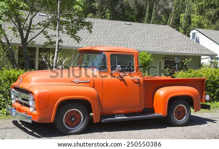 NAPA VALLEY, CA - APRIL 14, 2014: 1956 Ford F-100 Custom Cab Pickup Truck in Napa Valley - stock photo