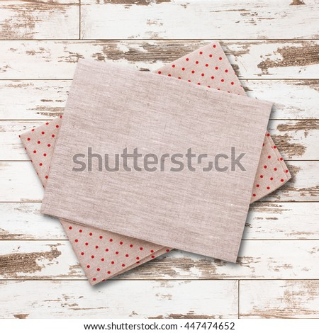 Napkin. Cloth napkin on white wooden background. Napkin top view, mock up. Wooden table top view square.