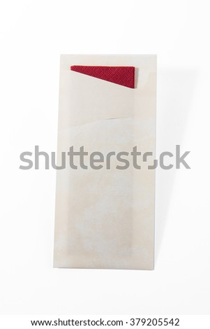 Napkin in cover  isolated on white background.Kitchen paper serviette.Domestic, cafe cloth.