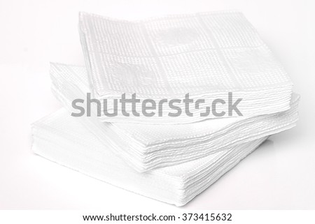 Napkin isolated on white background. Kitchen paper serviette. Clean food towel in restaurant. Single square shape object. Blank tablecloth on table. Domestic, cafe cloth.
