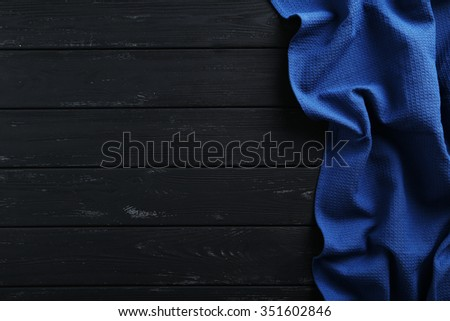 Napkin on black wooden table, close up - stock photo