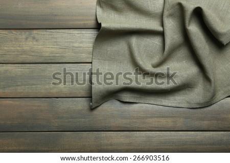Napkin on wooden table - stock photo