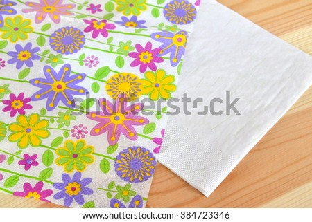 Napkin with flower pattern divided into 2 parts for decoupage - stock photo