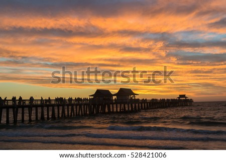 NAPLES, FL-Sunset at Florida's Gulf Coast at the Naples Pier in Naples, Forida on November 26, 2016