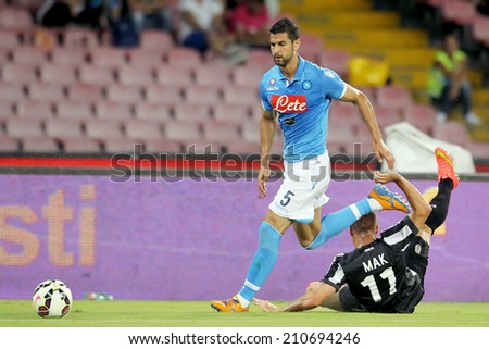 NAPLES, ITALY- AUGUST 2, 2014: Robert Mak of PAOK (R) in action with Miguel Britos of Napoli (L) during the friendly match Napoli vs Paok.