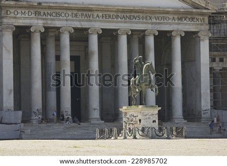 Naples, Italy, August 10 2014: San Francesco di Paola church in Piazza del Plebiscito Naples, close up of the colonnade and the statue