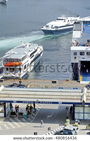 NAPLES, ITALY - CIRCA OCTOBER 2007: Entrance to the ferry terminal with ferries docks and one departing