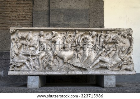 NAPLES, ITALY - JULY 22 2015: Ancient Roman sarcophagus on display in the Naples National Archaeological Museum. Elaborately carved sarcophagi were characteristic from the 2nd to the 4th centuries AD - stock photo