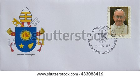 NAPLES, ITALY - JUNE 7, 2016: First Day Cover (FDC) of an Italy stamp dedicated to Pope Francis, released on MAY 2, 2013. The emblem of Pope Francis is represented on the envelope. - stock photo
