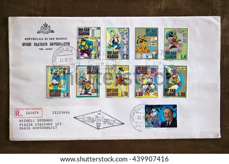 NAPLES, ITALY - JUNE 12, 2016: First day cover of San Marino state (Italy) stamps released on December 22,1970, dispatched to Minturno, Italy. The series shows some Disney characters. - stock photo