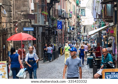 NAPLES, ITALY- JUNE 26, 2014: Street in historic center of Naples, Italy. Naples historic city center is the largest in Europe, and is listed by UNESCO as a World Heritage Site. - stock photo
