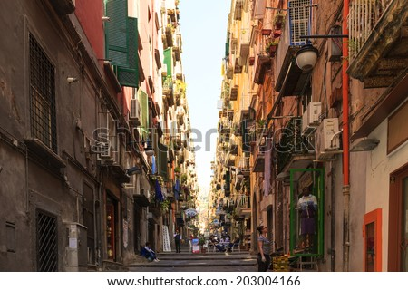 """NAPLES, ITALY - MAY 22, 2014: The neighborhood called """"Quartieri Spagnoli"""" in Naples in a typical day,  with colorful streets and fessed are a world attraction. to many tourists.   - stock photo"""