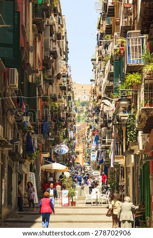 "NAPLES, ITALY - MAY 22, 2014: The neighborhood called ""Quartieri Spagnoli"" in Naples in a typical day, with colorful streets and fessed are a world attraction. to many tourists.  - stock photo"